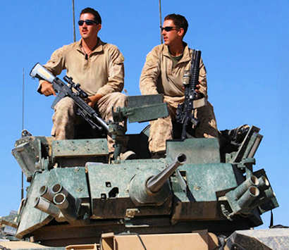 Lance Cpl. Matthew C. Rehbein (right), a section leader in 1st Platoon, A Company, 3rd Light Armored Reconnaissance Battalion, and Lance Cpl. Justin D. Batterson, a designated marksman for 1st Platoon, sit in the turret of their Light Armored Vehicle 25 at Firebase 0/0 in Helmand province, Afghanistan, April 21, 2011. Rehbein and Batterson joined the Marine Corps together in 2008 after growing up with each other in Rochester, Minn.