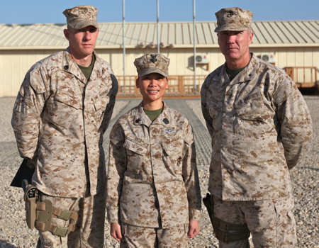 Petty Officer 1st Class Chat Rice (center), leading petty officer of patient tracker, Health Services Support Element, G-3, 1st Marine Logistics Group (Forward), poses with her husband, Staff Sgt. Jeff Rice (left), radio chief and spectrum manager, G-6, 1st MLG (FWD), and Brig. Gen. Charles L. Hudson, commanding general of 1st MLG (FWD), after her reenlistment ceremony at Camp Leatherneck, Afghanistan, Jan. 21, 2011. The dual-military couple is currently deployed together in support of Operation Enduring Freedom.