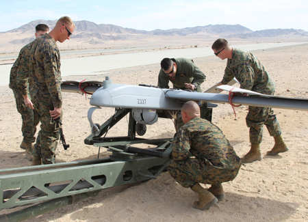 Vehicle operators and maintainers inspect an RQ-7B Shadow, unmanned aerial vehicle before launch at the Marine Unmanned Aerial Vehicle Squadron 1 airfield aboard the Combat Center Feb. 15, 2011.