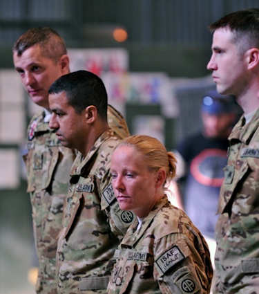 From left to right, Maj. Graham Bundy, Chief Warrant Officer 2 Christopher DeOliveira, Staff Sgt. Erin Gibson, and Sgt. Robert Wengeler, all with C Company, 3rd Battalion, 82nd Combat Aviation Brigade. All four Army Commendation Medals for valor Nov. 11, 2011 for saving two critically-injured French soldiers while under fire in the Tagab valley on Sept. 7, 2011. Photo by Army Sgt. 1st Class Eric Pahon