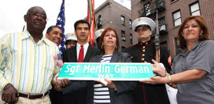 "Recruiting Station New York (4/30/2011) --  Hemery German, New York State Senator Adriano Espaillat, Manhattan Borough President Ydanis Rodriguez, Lourdes German, Marines from the 1st Marine Corps District and Norma Guerra pose with the new street name ""Sgt. Merlin German Way."" Hemery and Lourdes are the parents of Sgt. Merlin German. ""Here we have the honor to be with the family and friends (of German),"" said Rodriguez. ""German will always be in our hearts. He will never die and he will never leave this community."" Photo by USMC Cpl. Colby Brown"