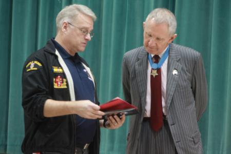 Brian Kirkpatrick, the middle school history teacher for Bolden Elementary, gives a certificate of appreciation to Maj. Gen. James Livingston, retired Marine Corps Medal of Honor recipient, at Bolden Elementary March 11, 2011. Livingston was given the certificate to recognize how much his visit meant to the students and faculty of the school.