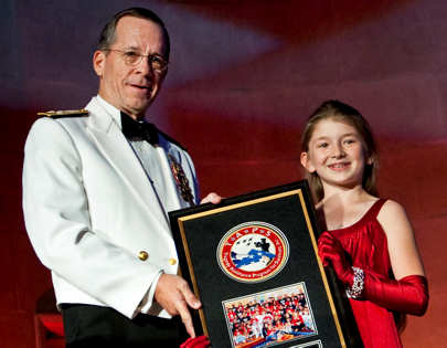 Cierra Becker presents Navy Adm. Mike Mullen, chairman of the Joint Chiefs of Staff, with an appreciation award at the annual Tragedy Assistance Program for Survivors Honor Guard Gala in Washington, D.C., April 5, 2011. DOD photo by U.S. Navy Petty Officer 1st Class Chad J. McNeeley