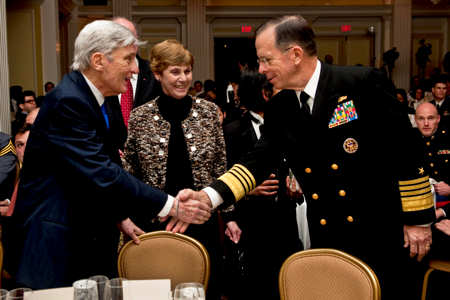 Navy Adm. Mike Mullen, chairman of the Joint Chiefs of Staff, and his wife, Deborah, greet retired Sen. John W. Warner of Virginia at the Center for the Study of the Presidency and Congress awards dinner in Washington, D.C., March 24, 2011. Mullen accepted the Dwight D. Eisenhower Award for excellence on behalf of the U.S. Armed Forces at the dinner. DOD photo by U.S. Navy Petty Officer 1st Class Chad J. McNeeley