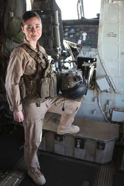 "Navy Lt. Sarah Ballard stands aboard a CH-53D Sea Stallion with the Marine Heavy Helicopter Squadron 362 ""Ugly Angels,"" 3rd Marine Aircraft Wing (Forward), at Camp Bastion, Afghanistan, Jan 17, 2011. Ballard, the squadron's flight surgeon who recently received the Richard Luehrs Memorial Award as the operational flight surgeon of the year, often volunteers to fly during combat missions as an aerial observer and on-call casualty evacuation doctor."