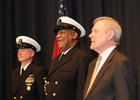Actor and comedian Bill Cosby stands between Master Chief Petty Officer of the Navy Rick D. West and Navy Secretary Ray Mabus during a Feb. 17, 2011, ceremony at the U.S. Navy Memorial in Washington, D.C., in which Cosby was recognized as an honorary chief petty officer. U.S. Navy photo by Petty Officer 2nd Class Jason M. Graham