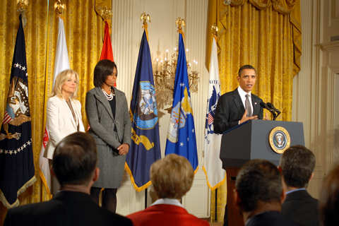 President Barack Obama announces a whole-of-government initiative to benefit military families as Dr. Jill Biden, wife of Vice President Joe Biden, and First Lady Michelle Obama look on during a Jan. 24, 2011, White House event. DOD photo by Elaine Wilson