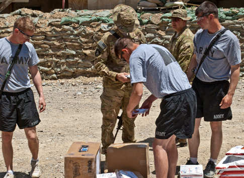 Soldiers at Forward Operating Base Tillman in Afghanistan's Paktika province sort through mail, their main means of receiving personal items on May 19, 2011. DOD photo by Karen Parrish