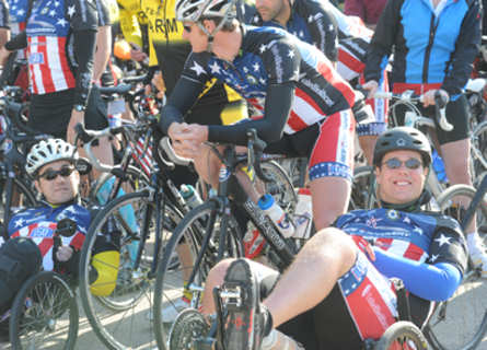 From right, Nathan Green, a retired airman who was wounded in 2008 during an insurgent rocket attack against the U.S. Embassy in Baghdad, Iraq, and Staff Sgt. Patrick Zeigler, who was wounded during the Nov. 5, 2009, shootings at Fort Hood, pause with fellow riders during a ceremony held March 31, 2011 at the flagpole near the III Corps and Fort Hood, Texas, Headquarters building.