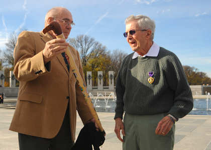 Retired Master Sgt. Hank Cloutier presents former1st Lt. Edward Moppert with an Eagle Cane during Moppert's Purple Heart medal ceremony Nov. 26, 2011, at the World War II Memorial in Washington. The Eagle Cane is presented to veterans who have received some manner of leg disability from combat related actions. U.S. Air Force photo/Master Sgt. Raheem Moore