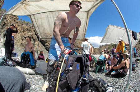 U.S. Army Sgt. Mathew White, prepares to hit the waters of Guantanamo Bay's Hidden Beach, Feb. 20, 2011. White and several other wounded warriors participated in the Soldiers Undertaking Disabled SCUBA, a program designed to help improve the lives of injured veterans returning from Iraq and Afghanistan.