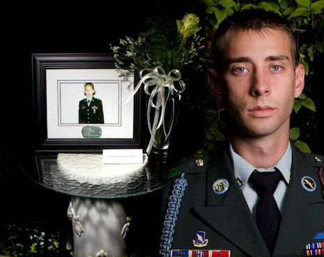 July 1, 2012 -5U.S. Army Sgt. Colton Hurley, an infantry team leader with the 82nd Airborne Division's 1st Brigade Combat Team, stands next to a memorial for his mother, Sgt. Krystal Hurley, in this undated photograph. Hurley was inspired to serve 20 years in the Army by his mother, a combat medic who passed away when he was an infant. Photo by Army Sgt. Mike MacLeod