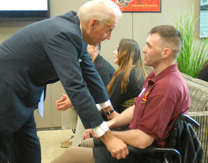 Vice President Joe Biden speaks with wounded warrior Marine Corps Sgt. James Amos during a visit to the Warrior Hope and Care Center on Marine Corps Base Camp Pendleton, Calif., Jan. 20, 2012. DOD photo by Elaine Sanchez