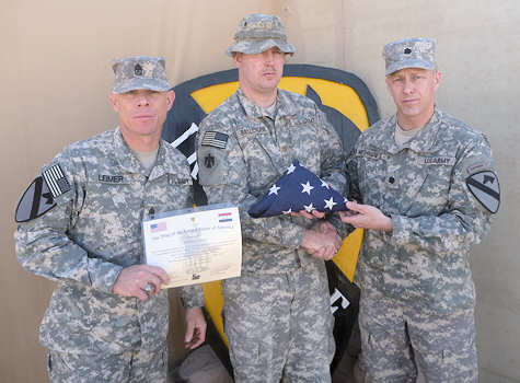 "Sgt. Maj. Robert Leimer, brigade operations sergeant major, and Lt. Col. David Northridge, deputy commander, both of 1st Brigade, 1st Cavalry Division, present a folded American flag and certificate to Maj. Andrew Ballenger, executive officer of 1st Squadron, 180th Cavalry, Oklahoma Army National Guard on December 7, 2011. The flag was the last flag to be flown over Forward Operating Base Kalsu, Iraq. FOB Kalsu was named after Oklahoma native Bob Kalsu, a first lieutenant who was killed in action in Vietnam July 21, 1970. Kalsu was best known for being an All-American football player for the University of Oklahoma, as well as being 1968's ""Rookie of the Year"" for the Buffalo Bills. The 180th Cavalry will present the flag and certificate to Kalsu's daughter.  Photo by Army Capt. James Robertson"