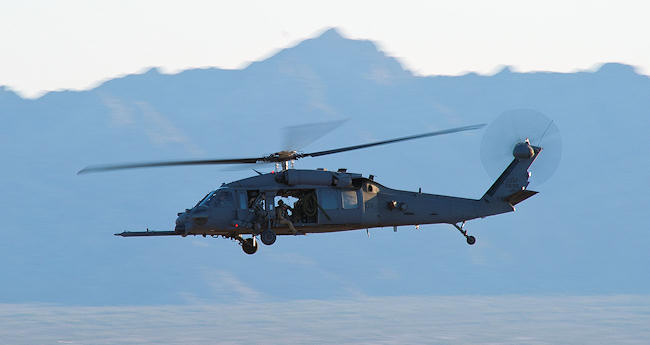 An HH-60 Pave Hawk assigned to the 55th Rescue Squadron at Davis-Monthan Air Force Base, Ariz., flies over the Barry M. Goldwater Range Complex, Ariz., May 3, 2012, in support of the Cactus Starfighter exercise. The Pave Hawk's participated in the combat search and rescue portion of the exercise, rescuing a simulated downed pilot. Staff Sgt. Jason Colbert
