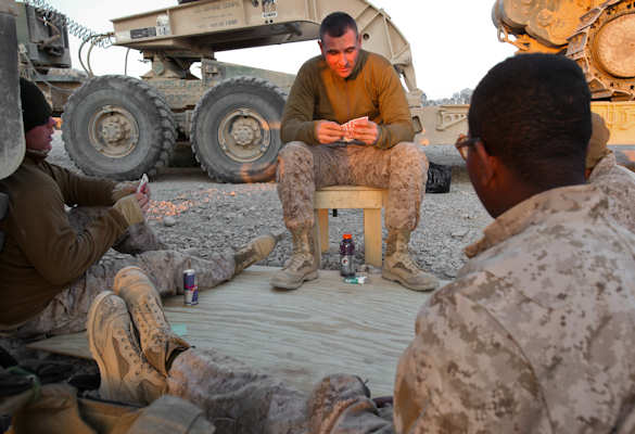Sgt. Nicholas Marchioni, a squad leader with 2nd platoon, Alpha Company, 9th Engineer Support Battalion, 2nd Marine Logistics Group (Forward), enjoys a game of spades with his Marines during some down time in a route reconnaissance mission, Jan. 2, 2012. The Detroit native is known as a father figure throughout the platoon. Photo by USMC Cpl. Meredith Brown