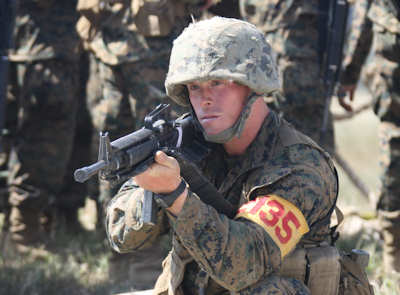 Recruit James Hibler, Platoon 2135 guide, Company F, 2nd Recruit Training Battalion, secures the area April 10, 2012 aboard Edson Range, Weapons and Field Training Battalion, Marine Corps Base Camp Pendleton. Hibler has displayed excellent leadership skills since at recruit training. He has been Plt. 2135's guide since training day one which is a hard title to maintain. Photo by USMC Lance Cpl. Crystal Druery