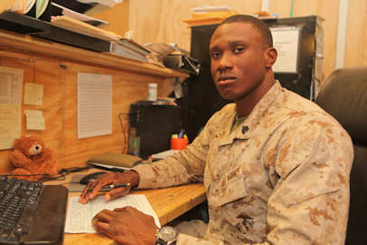 Sergeant Mamadee Toure, who hails from Atlanta, is a supply liaison for units in 2nd Marine Division (Forward). Mamadee said if a piece of equipment needs parts, that he is responsible for ordering and tracking the items. Photo by USMC Sgt. Earnest J. Barnes, Jan. 12, 2012