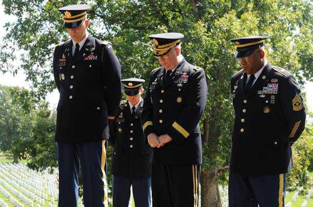 (Left) Capt. Brandon Denning, 4th Battalion Chaplain, 3d U.S. Infantry Regiment (The Old Guard), joins U.S. Army Chief of Chaplains, Maj. Gen. Don Rutherford, and Sgt. Maj. Stephen Stott, Chaplain Corps regimental sergeant major as they bow their heads in prayer during the 237th anniversary of the Chaplains Corps, July 27, 2012 in Arlington National Cemetery, Va. The chaplains were marking the event by laying a wreath at the Chaplains' Memorial, an event hosted by the 3rd U.S. Infantry Regiment (The Old Guard)