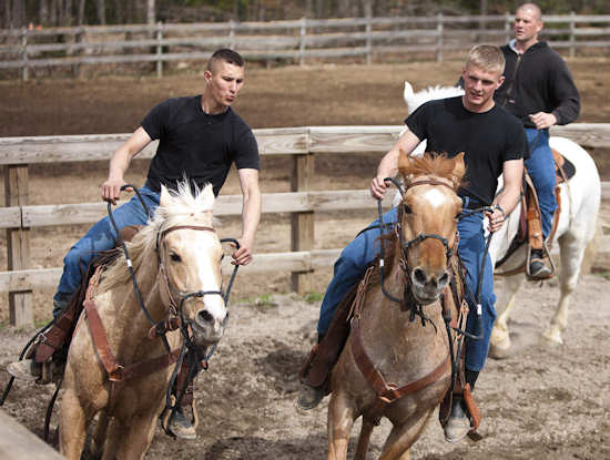 Pfc. Tyler Meyers (left) rides Corona, Sgt. Christopher Thore (right) rides Tazi, and Pvt. Chad Braithwaite (background) rides Duke during a training on Fort Belvoir, Va., March 2, 2012. They, along with three other Soldiers, are training to be part of the Caisson Platoon. Photo by Rachel Larue