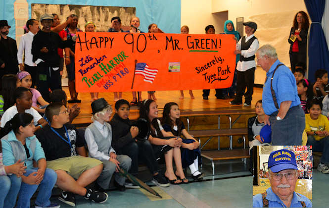 "Students at Tyee Park Elementary School, Lakewood, Wash., sing ""Happy Birthday"" to retired Chief Petty Officer and Pearl Harbor survivor, Donald R. Green on May 30, 2012 prior to the school's spring concert. It was Green's 90th birthday and he was presented an orange banner that displayed ""Let's remember Pearl Harbor"" which had over 400 signatures from students and faculty members. Fourth- and fifth-grade students performed a musical adaption of the Charles Dicken's classic, ""Oliver Twist."" First-, second- and third-graders performed in an upbeat jazz concert. Photo by Army Staff Sgt. Teresa Adams"