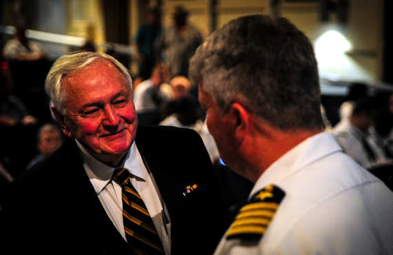 U.S. Navy Capt. Thomas Bailey, Joint Base Charleston deputy commander, speaks with John Hancock, retired U.S. Navy captain and Battle of Midway survivor, before the Battle of Midway ceremony on board the USS Yorktown (CV-10), S.C., June 4, 2012. Hancock was on board the USS Yorktown (CV-5) during the battle. He served as a machine-gun operator and suffered wounds to his neck as well as a collapsed lung during the attack. Photo by USAF Airman 1st Class Dennis Sloan