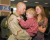 U.S. Navy Construction Mechanic 2nd Class Jeremy Kroeger, attached to Cargo Transfer Platoon (CTP) 1, greets his wife and son in Norfolk, Va., after returning from a deployment Feb. 12, 2007.
