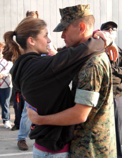 U.S. Marine Corps Lance Cpl. R.J. Smith says goodbye to his fiance at Naval Base San Diego, Calif., April 10, 2007, before boarding the amphibious assault ship USS Bonhomme Richard (LHD 6) for a six month deployment in support of the war on terror. Smith is assigned from 13th Marine Expeditionary Unit, Expeditionary Strike Group Five.