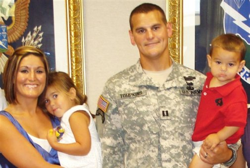 November 2010 -- Army Capt. Todd Tomkins poses for a picture with his wife, Annette, and two children, Taylor and Todd. Tomkins, on his fifth deployment, will spend Thanksgiving in Afghanistan, helping to refurbish a school in a nearby village. Courtesy photo
