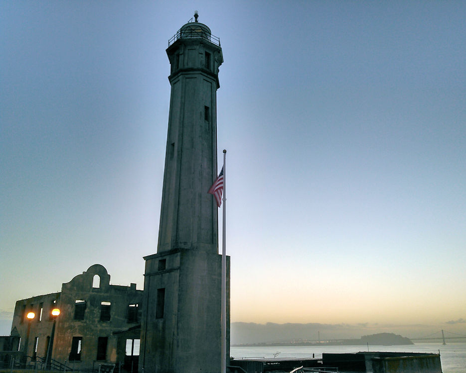 (Alcatraz Lighthouse on San Francisco Bay during sunrise on October 22, 2015. The 84-foot tall tower has stood in the center of the Bay since 1909, replacing the original one damaged by an earthquake in 1906. (U.S. Coast Guard photo by Chief Petty Officer Robert Sevon)