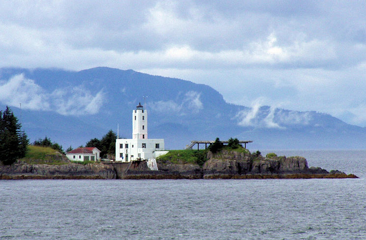 September 3, 2012 - The 68-foot-tall Five Finger Islands Light, built in 1902, towers over a group of five rocky islands that appear during low tide and look like a hand reaching into Alaska's Frederick Sound. (Photo provided through Wikipedia)