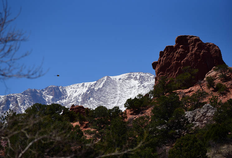 April 7, 2016 - Pike's Peak looms over the red-orange monolithic rock formations known throughout the U.S. as the Garden of the Gods. Spanning 1,367 acres of terrain ranging from scrub lands to high tundra, the garden is one of the most heavily photographed sites in the Colorado Springs area .(U.S. Air Force photo by Staff Sgt. Amber Grimm)