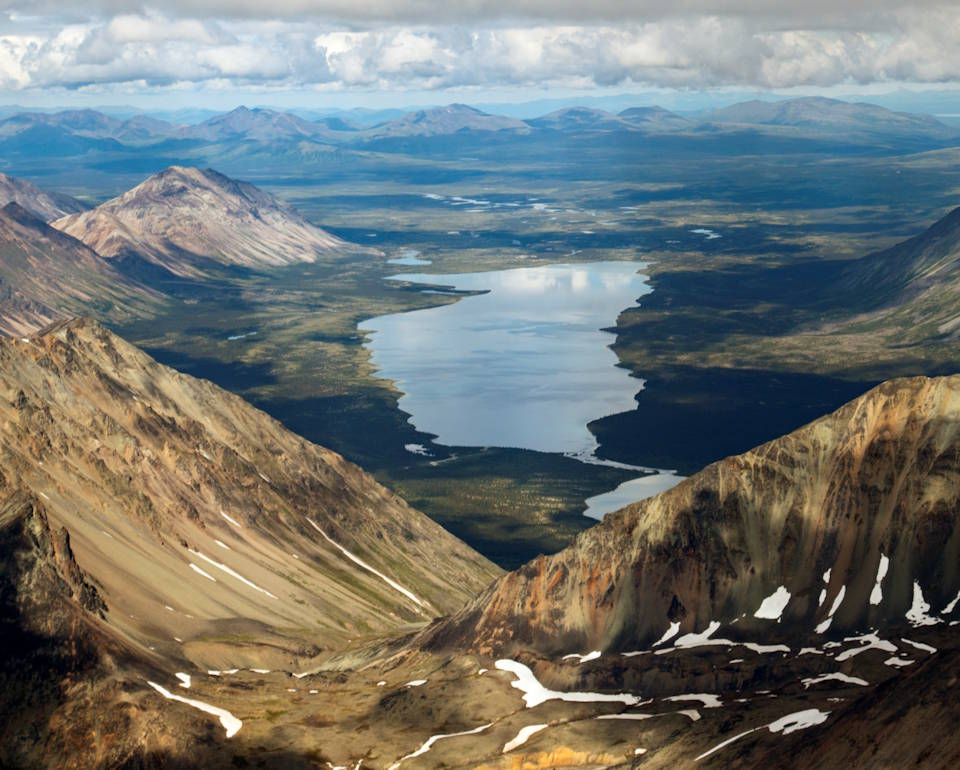 Majestic aerial view of Lower Twin Lake nestled behind the rust colored Neacola Mountains in the Lake Clark National Park and Preserve. (Image created by USA Patriotism! from U.S. National Park Service photo by T. Vaughn.)