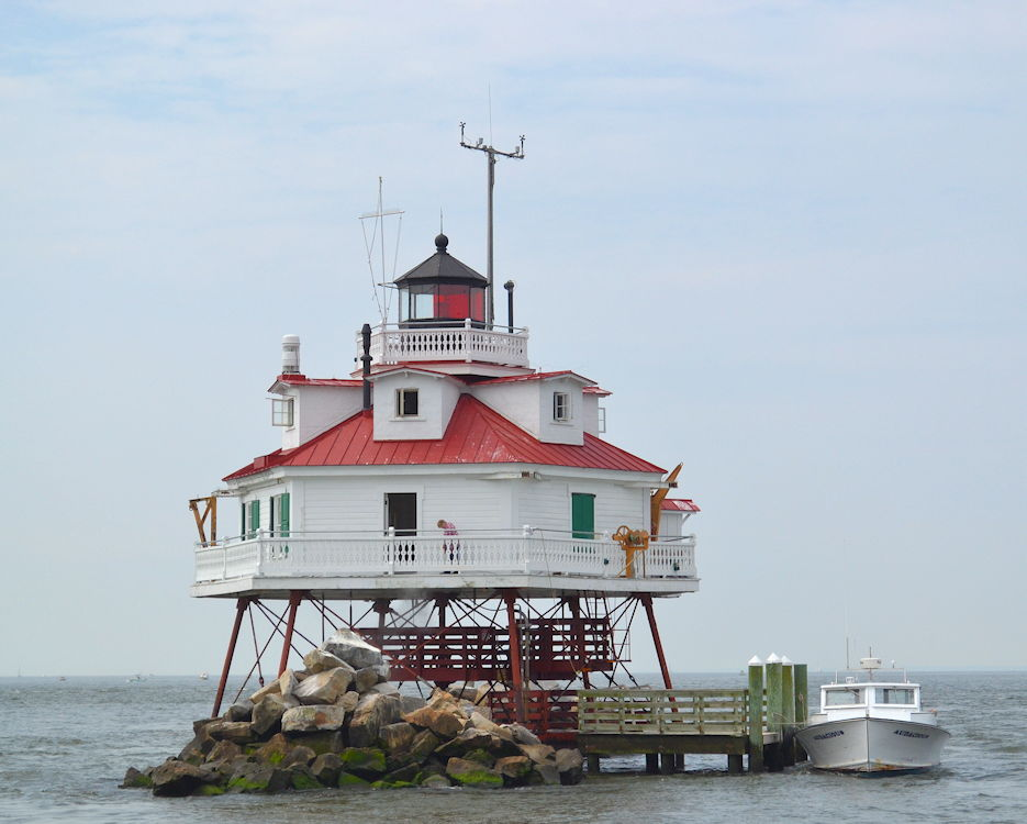 May 18, 2019 - The Thomas Point Lighthouse is the last active screw-pile lighthouse on its original foundation in the U.S. and the last lighthouse manned by U.S. Coast Guardsmen on the Chesapeake Bay. The light is maintained by Aids to Navigation Team Baltimore. (U.S. Coast Guard photo by Walter Ham)