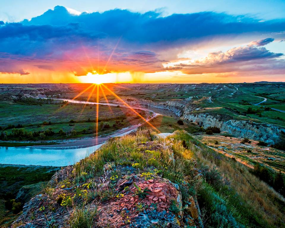 Nature's sunrise beauty is wonderfully displayed over the terrain at North Dakota's Theodore Roosevelt National Park on June 4, 2014. (Image created by USA Patriotism! from U.S. National Park Service courtesy photo)
