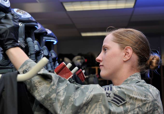 Senior Airman Amanda Stinnett, 3rd Operation Support Squadron aircrew flight equipment journeyman, checks oxygen hoses for leaks at the 90th Fighter Squadron on Joint Base Elmendorf-Richardson July 8, 2013. As an AFE journeyman, Stinnett inspects and maintains equipment used by pilots. Stinnett won the Aircrew Flight Equipment Award in 2012, which recognizes outstanding accomplishments from airmen in the AFE career field. (U.S. Air Force photo/Airman 1st Class Tammie Ramsouer)