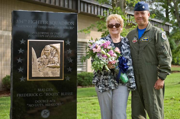 "Betty Blesse, wife of late Maj. Gen. Frederick ""Boots"" Blesse, stands with Lt. Col. Donn Yates, 334th Fighter Squadron commander, after the unveiling of her late husband's monument during a memorial dedication ceremony, June 27, 2014, at Seymour Johnson Air Force Base, N.C. The memorial was constructed at the front of the 334th Fighter Squadron, the unit Blesse was assigned to when he recorded his 10th aerial kill. (U.S. Air Force photo/ by irman 1st Class Aaron J. Jenne)"