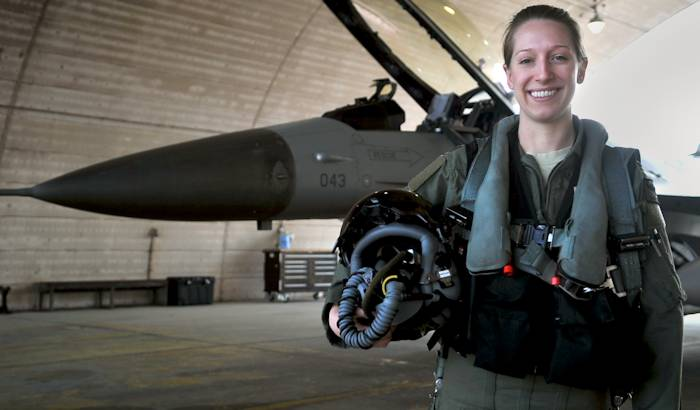 First Lt. Clancly Morrical, 36th Fighter Squadron pilot, stands by her F-16 Fighting Falcon March 13, 2013, at Osan Air Base, South Korea. Morrical is Osan's only female pilot. (U.S. Air Force photo by Senior Airman Alexis Siekert)