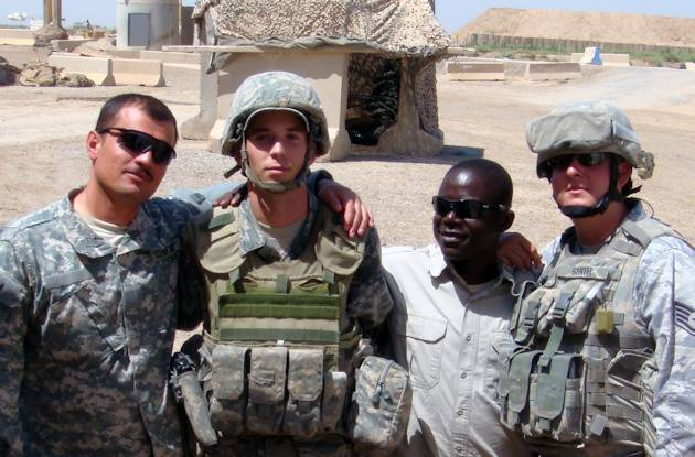 Staff Sgt. Daniel Ball (second left), 366th Security Forces Squadron controller, and other Defenders pose for a photo at a deployed location in Iraq on August 27, 2009. With rockets exploding around him and an entry control point in complete chaos, Ball, a graduate of Yuba City High School, Calif., took decisive action to help quell the enemy threat and treat wounded comrades. (courtesy photo)
