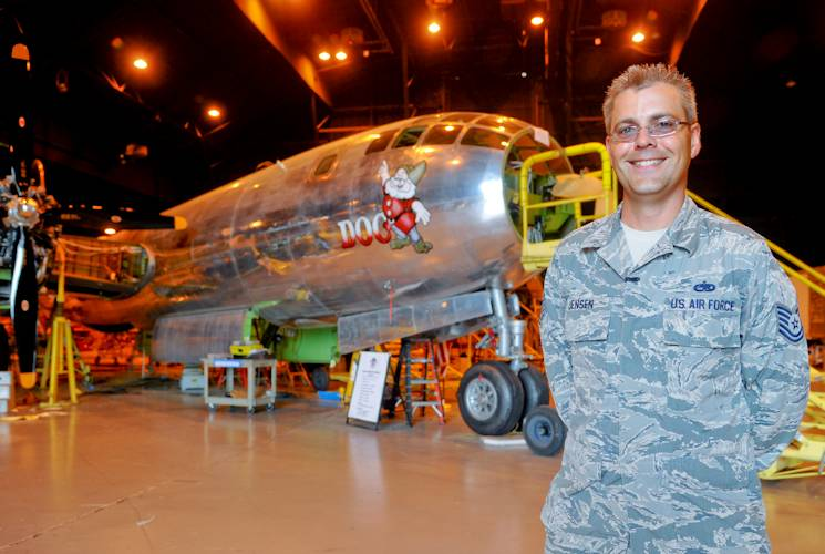 U.S. Air Force Tech. Sgt. Geoffrey Jensen, 22nd Maintenance Group logistic resource management program NCO in charge, stands in front of Doc, a B-29 Superfortress, July 22, 2014, inside a Boeing hangar, in Wichita, Kansas. Jensen joined a volunteer group, Friends of Doc, which is restoring the aircraft to flying condition. (U.S. Air Force photo by Airman 1st Class John Linzmeier)