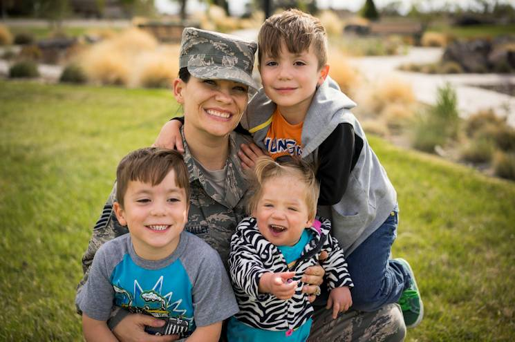 Air Force Tech. Sgt. Jamie Meadows-Valley, 366th Aerospace Medicine Squadron, poses for a photo with her twin sons, Wolfgang and Jaeger, and her newly adopted daughter Oleksandra at Mountain Home Air Force Base, Idaho, on May 6, 2014. (U.S. Air Force photo by Tech. Sgt. Samuel Morse)