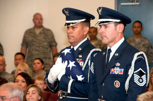 "USAF Tech. Sgt. Michael Brizuela, left, performs a flag folding ceremony at a military retirement at the 162nd Fighter Wing in Tucson, Ariz on September 10, 2011. Thirty years ago this Memorial Day he first signed up for honor guard duty and has steadily volunteered ever since. ""I'm just grateful I can still do this all these years later. I want to be useful to the end and I hope I can even help post the colors at my own retirement one day,"" Brizuela said. U.S. Air Force photo by USAF Master Sgt. Dave Neve"