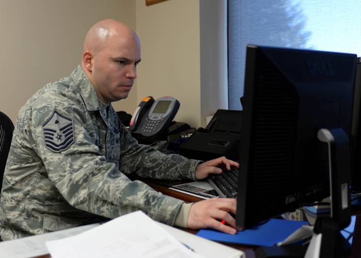 Master Sgt. Patrick Hill, 28th Medical Group first sergeant, updates paperwork and responds to base personnel inquiries at his workstation at Ellsworth Air Force Base, S.D., Nov. 13, 2014. As a first sergeant, much of each day is dedicated to staying informed and properly responding to Airmen's needs. (U.S. Air Force photo by Senior Airman Anania Tekurio)