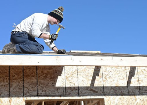 Senior Airman Travis Bellefeuille, 28th Operations Support Squadron targeteer, builds a roof during a Habitat for Humanity project in Summerset, S.D., Nov. 8, 2014. Bellefeuille and several other Ellsworth Airmen dedicated their time constructing a roof for a house that will be provided to a Habitat family in need. Habitat Black Hills Area volunteers have helped house over 300 people in the local area. (U.S. Air Force photo by Senior Airman Anania Tekurio)