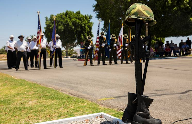 A memorial to fallen troops stands before a Memorial Day ceremony at the Sunset Vista Cemetery in Yuma, Ariz., May 26, 2014. The American Legion Federal Post No. 19, along with fellow veteran organizations and local authorities, provided honor guards to the various Memorial Day ceremonies in Yuma to show their support and fidelity.(U.S. Marine Corps photo by Lance Cpl. James Marchetti)