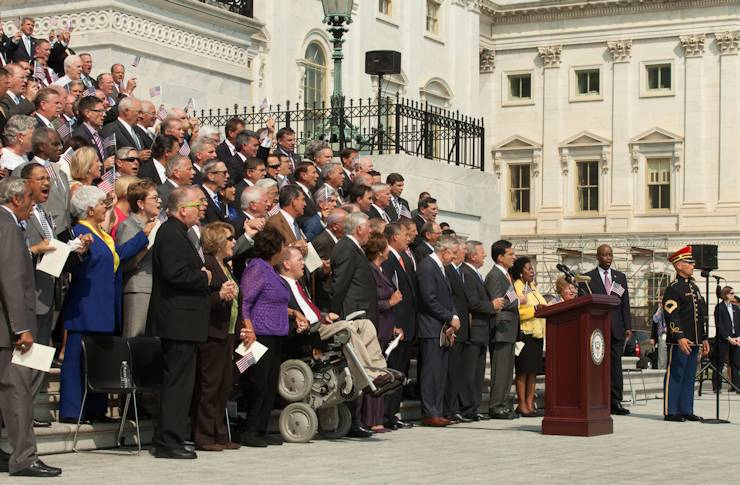 Army Master Sgt. Antonio Giuliano, first tenor section leader for the U.S. Army Band's Army Chorus, sings the Star Spangled Banner as members of Congress gather on the steps of the U.S. Capitol for the 12th annual September 11th National Day of Service and Remembrance, Sept. 11, 2013. (House of Representatives photo by Heather Reed)