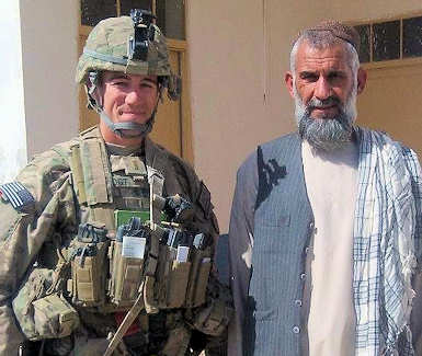 First Lt. Nicholas Vogt, platoon leader with the 1st Battalion, 5th Infantry Regiment, 1st Stryker Brigade Combat Team, 25th Infantry Division, stands next to a village elder during a mission in Kandahar province, Afghanistan on Oct. 1, 2011. Courtesy Photo