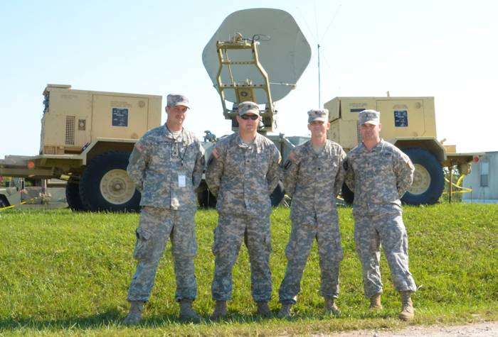 U.S. Army Spc. Micaiah Glover and his brother 1st Lt. Elijah Glover, right, and Sgt. Brandon Corey McAlpin and his brother Sgt. Richard Kyle McAlpin, all assigned to the 146th Expeditionary Signal Battalion provide a Satellite Transportable Terminal for use during exercise Vibrant Response 13-2 at Camp Atterbury, Indiana on August 5, 2013. Vibrant Response is a U.S. Northern Command-sponsored field training exercise for chemical, biological, radiological, nuclear and high-yield explosive consequence management forces designed to improve their ability to respond to catastrophic incidents. (U.S. Army photo by Sgt. Alfonso Corral)