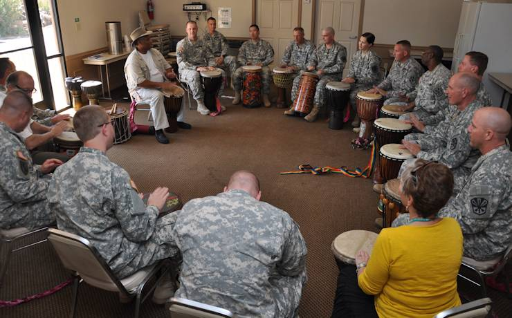 Chaplains and chaplain assistants from the Arizona Army National Guard participate in a drumming therapy class during a recent spiritual training course at the Franciscan Renewal Center in Scottsdale, AZ on September 21, 2013. (U.S. Army photo by Sgt. Lauren Twigg)