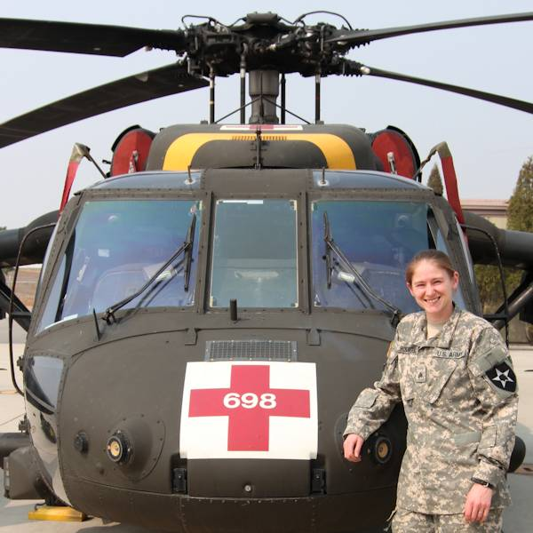 Army Sgt. Lisa A. Rodriguez, a flight medic with Company C, 3rd General Support Aviation Battalion, 2nd Combat Aviation Brigade, 2nd Infantry Division, in front of the aircraft she is assigned to at Camp Humphreys, South Korea on April 10, 2014. (U.S. Army photo by Sgt. 1st Class Vincent Abril)